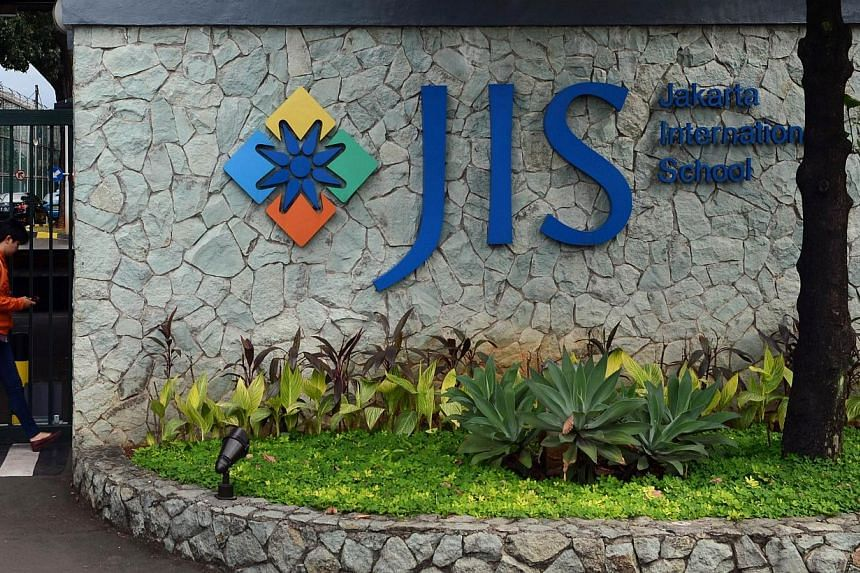 This file photo taken on April 21, 2014 shows the main entrance of the Jakarta International School in the Indonesian capital city of Jakarta. -- PHOTO: AFP