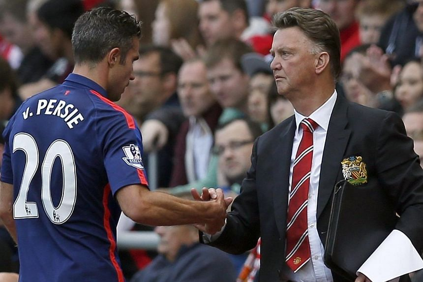 Manchester United manager Louis Van Gaal (right) shakes hands with striker Robin Van Persie after substituting him during their English Premier League football match against Sunderland at the Stadium of Light in Sunderland, northern England on Aug 24