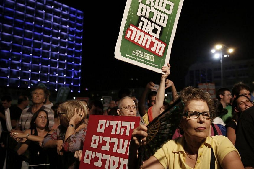 Israelis at a peace rally calling on the Israeli government to negotiate with the Palestinian Authority. Mass rallies aside, the writers find that positive personal contact among individuals from opposing groups can help pave the way towards peace.