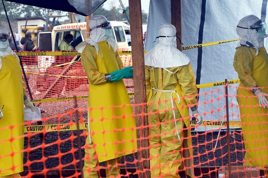 French NGO Medecins Sans Frontieres (MSF - Doctors Without Borders) staff members standing wearing protective gear at the MSF ELWA hospital in Monrovia, where patients suffering from Ebola are taken care of. A Liberian doctor treated with experimenta