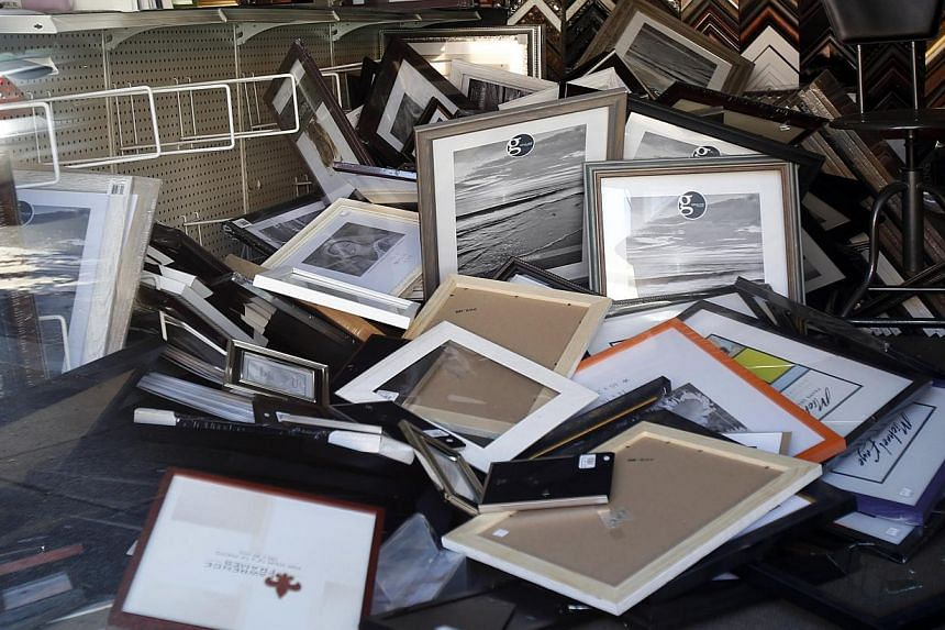 Fallen picture frames are seen inside a store after an earthquake in Napa, California on August 24, 2014. -- PHOTO: REUTERS