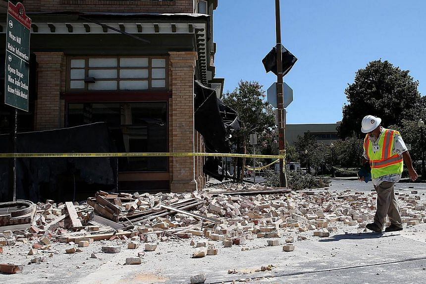 Dan Kavarian, chief building official with the City of Napa, surveys a building that was damaged by a 6.0 earthquake in Napa, California on August 24, 2014. -- PHOTO: AFP