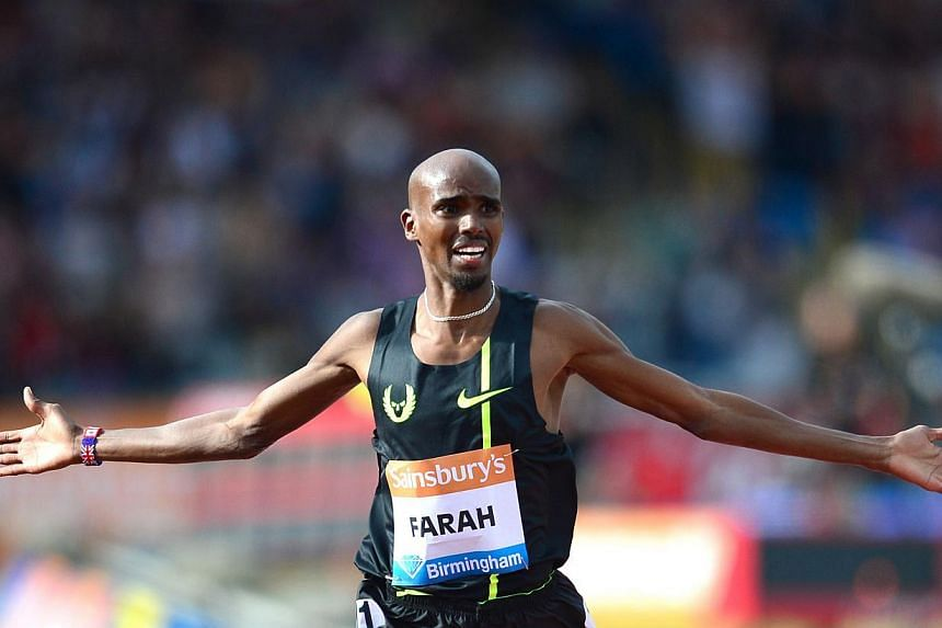 Britain's Mo Farah celebrates after winning the men's two-mile race during the Diamond League Athletics meeting in Birmingham on August 24, 2014. -- PHOTO: AFP