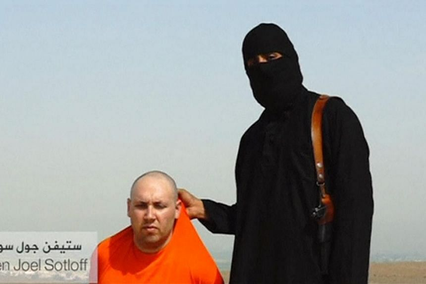According to British media reports yesterday, British intelligence agencies MI5 and MI6 believe the hooded man with an English accent to be 24-year-old Abdel-Majed Abdel Bary, known to fellow ISIS militants as Jihadi John.-- PHOTO: REUTER