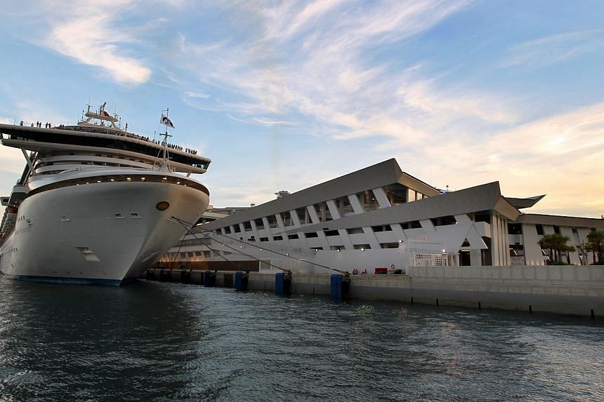 The improvements to the Marina Bay Cruise Centre, in response to problems like immigration bottlenecks and a lack of cabs previously, will be completed in time for the November high season, terminal operator Sats-Creuers said. -- ST PHOTO: CHEW