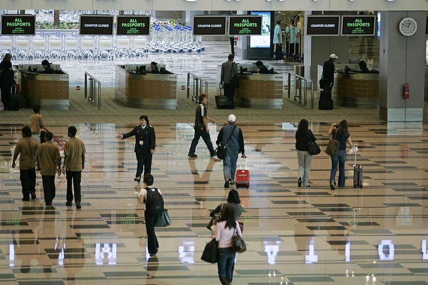 From Sept 1, foreign visitors and Singapore residents will be required to make a declaration if the money they carry in or out of the country exceeds S$20,000. -- PHOTO: ST FILE