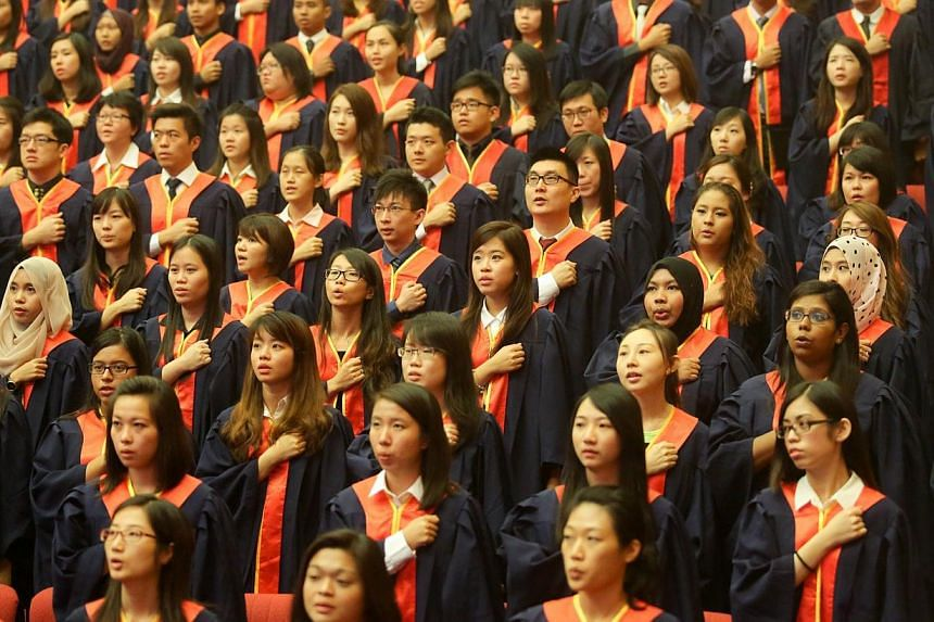 National Institute of Education (NIE) graduates reciting the teacher's pledge during a graduation ceremony held at Nanyang Technological University on July 9, 2014. -- PHOTO: ST FILE