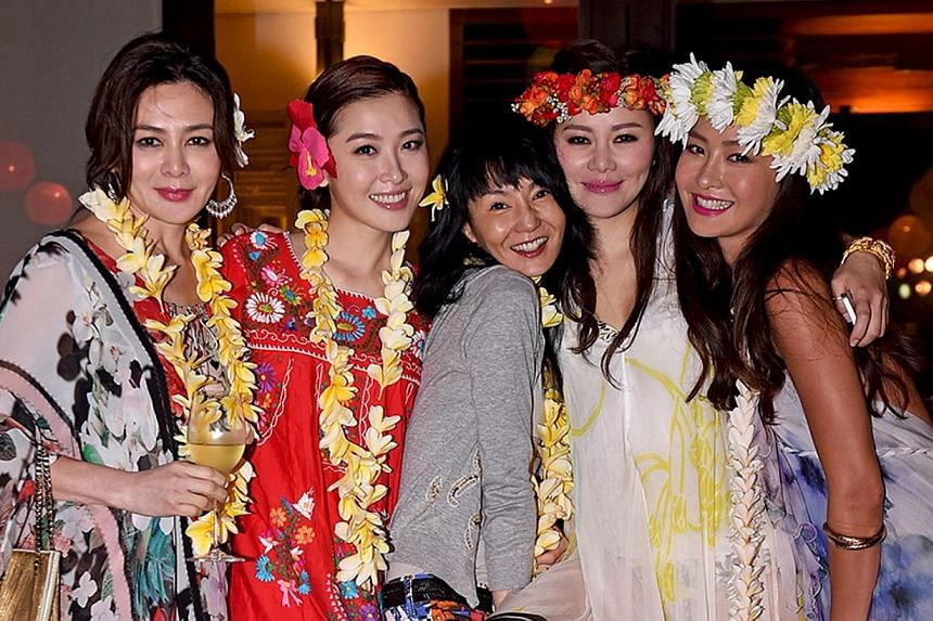 The wedding kicked off with a Hawaiian-themed weekend welcome party, attended by (from left) Rosamund Kwan, Niki Chow, Maggie Cheung, Fan and Kathy Chow.-- PHOTO: KENNY BEE