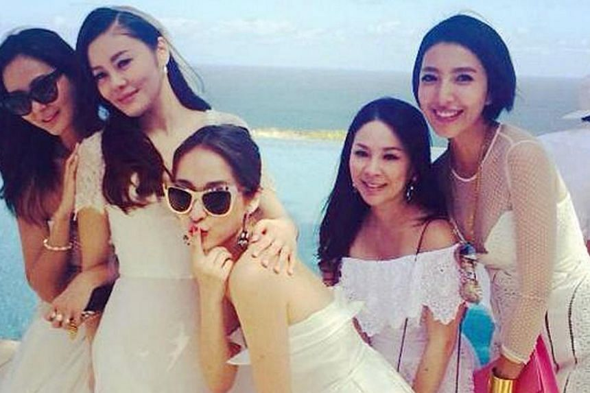 Fan Chiang (in veil) posing with her Taiwanese friends at Monday's wedding. -- PHOTO: KENNY BEE