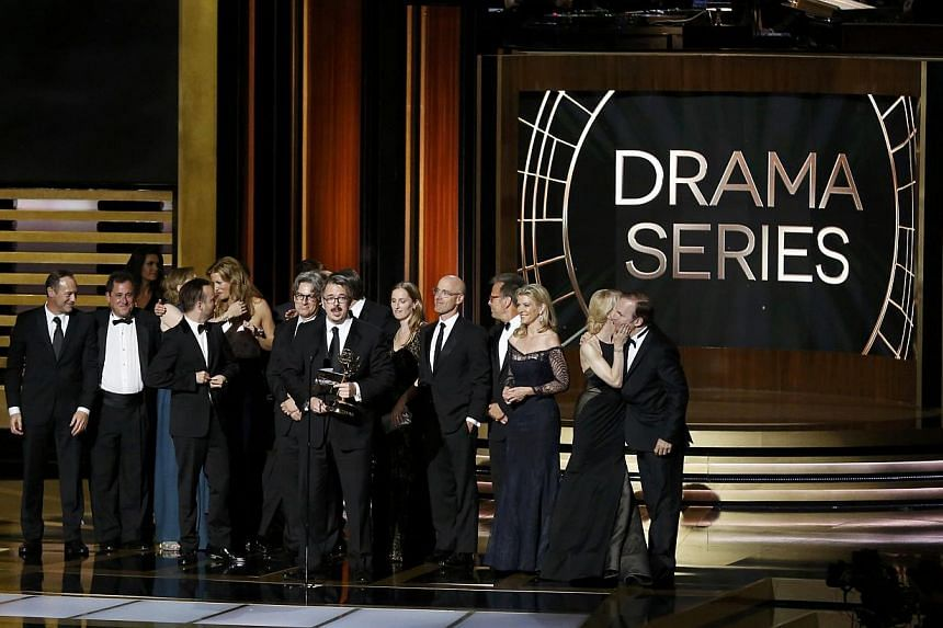 Producer Vince Gilligan accepting the award for Outstanding Drama Series with the cast and crew of Breaking Bad at the Emmy awards. The AMC show also picked up three top acting awards for its stars Bryan Cranston, Anna Gunn and Aaron Paul. -- PHOTO: