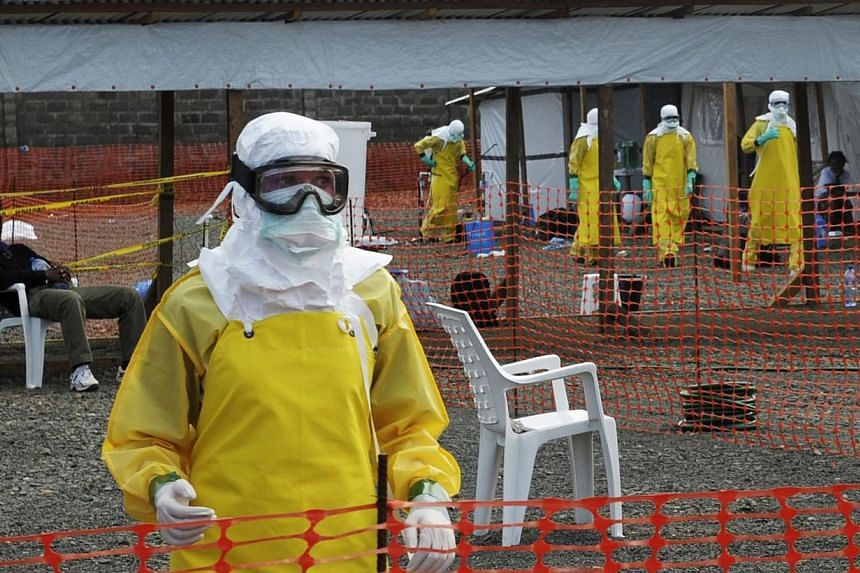 Medicins Sans Frontieres (MSF) health workers prepare at ELWA's isolation camp during the visit of Senior United Nations System Coordinator for Ebola David Nabarro, at the camp in Monrovia on Aug 23, 2014. The head of the US Agency for Internati