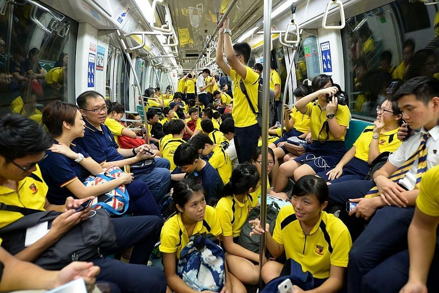 ACS chartered five MRT trains on the Circle Line to transport its supporters from One North to Stadium.-- ST PHOTO:JAMIE KOH