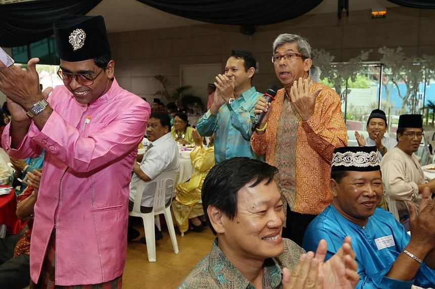 Minister for Communications and Information and Minister-in-charge of Muslim Affairs Dr Yaacob Ibrahim speaks at a Hari Raya celebration organised by the People's Association Malay Activity Executive Committees Council (MESRA) and attended by about 4