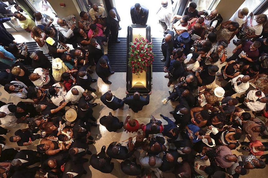 Family and supporters of Michael Brown celebrated the life of the black teenager killed by a white police officer in Ferguson, Missouri, in a music-filled funeral service ringing with calls for peace and police reforms. -- PHOTO: REUTERS