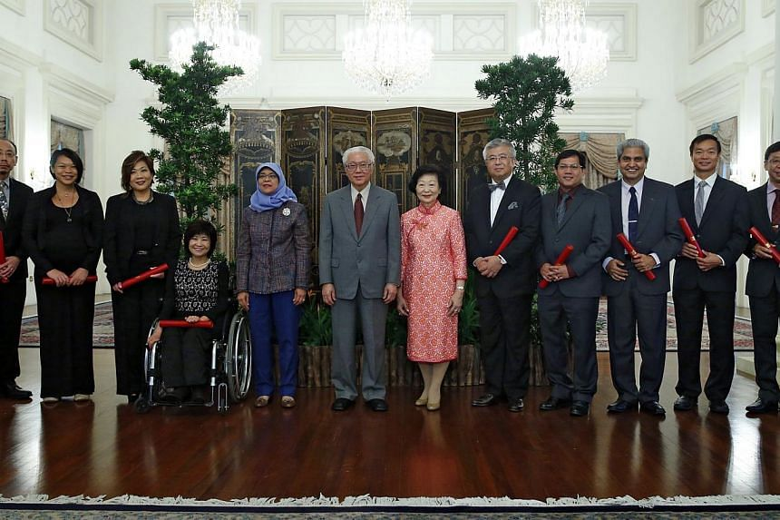 At the Istana after the ceremony are (from left) Nominated Members of Parliament associate professor Randolph Tan, Kuik Shiao-Yin, Rita Soh, Chia Yong Yong, Speaker of Parliament Halimah Yacob, President Tony Tan Keng Yam and wife Mary Tan, NMPs Thom