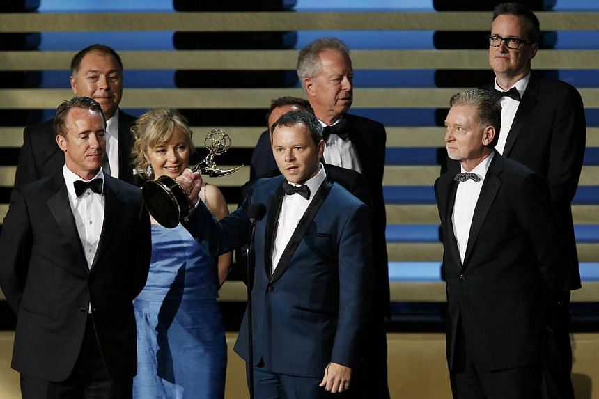 Executive producer Noah Hawley accepting the Outstanding Miniseries Award for Fargo, the TV re-imagining of the Coen brothers' cult film, at the Primetime Emmy Awards on Monday. -- PHOTO: REUTERS