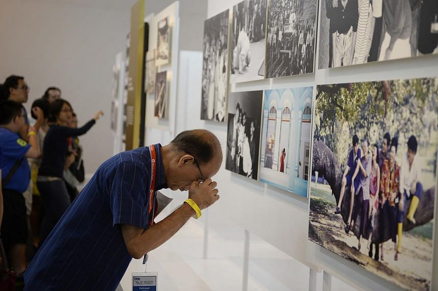 Visitors at the We: Defining Stories exhibition, presented by The Straits Times and the National Museum of Singapore, on 2 May 2014. -- PHOTO: ST FILE