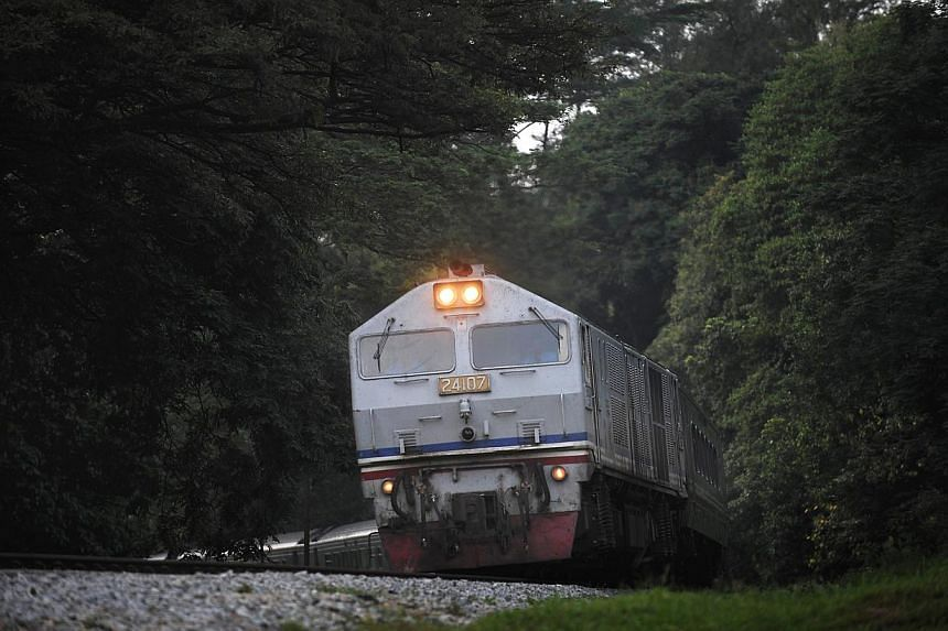 """File photo of a KTM railway train in Singapore. A dispute between Singapore and Malaysia over a tax levied on parcels of former railway land will be resolved soon, with a decision by a London arbitration panel expected in a """"few months"""". -- ST FILE P"""