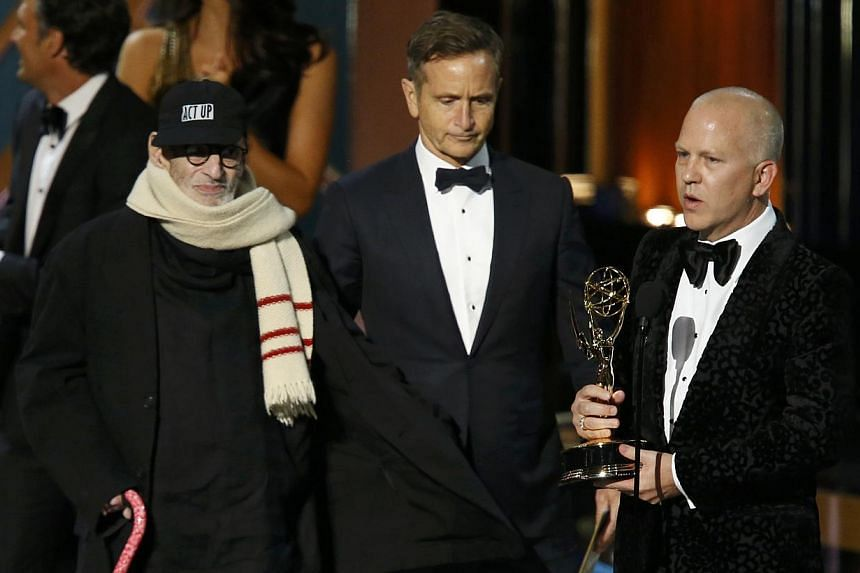 Executive producer Ryan Murphy (right) accepting the award for Outstanding Television Movie for The Normal Heart, with playwright Larry Kramer (left) onstage during the 66th Primetime Emmy Awards in Los Angeles. -- PHOTO: REUTERS