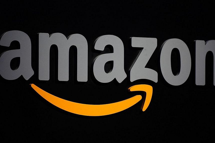 A file photo showing the Amazon logo displayed at a press conference in New York. The Internet retail giant is buying the videogame platform Twitch for US$1 billion (S$1.2 billion), The Wall Street Journal reported Monday. -- PHOTO: AFP