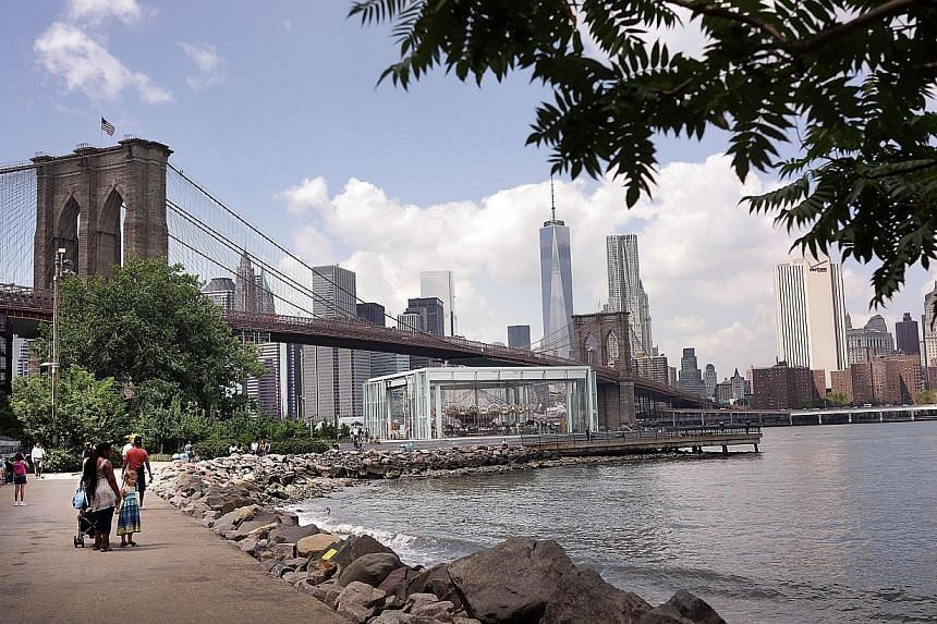The Brooklyn Bridge is viewed from a park in DUMBO - an acronym for Down Under the Manhattan Bridge Overpass - on August 19, 2014 in the Brooklyn borough of New York City. A Russian tourist was arrested, police said on Monday, after scaling the