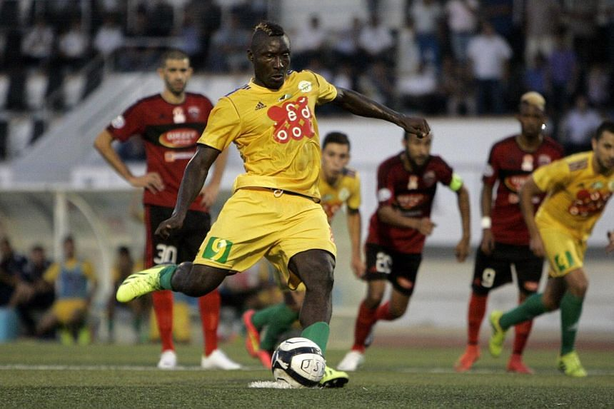 JS Kabylie's Cameroonian striker Albert Ebosse (centre) converts a penalty during his team's match with USM Alger in the city of Tizi-Ouzou, in the mainly Berber region of Kabylie east of the capital, on August 23, 2014. Ebosse died on August 23, aft