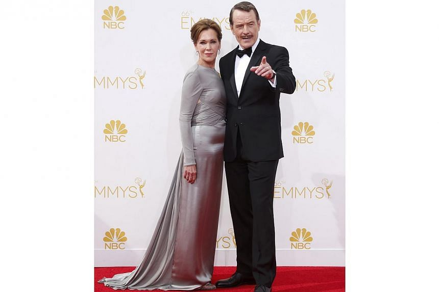 Actor Bryan Cranston, from the AMC drama series Breaking Bad, arrives with his wife Robin at the 66th Primetime Emmy Awards in Los Angeles, California on Aug 25, 2014. -- PHOTO: REUTERS