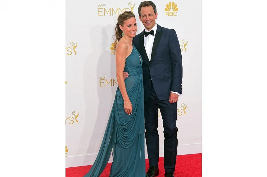 Emmy host Seth Meyers with his wife Alexi Ashe on the red carpet at the 66th Emmy Awards, on Aug 25, 2014, at Nokia Theatre in Los Angeles, California. -- PHOTO: AFP