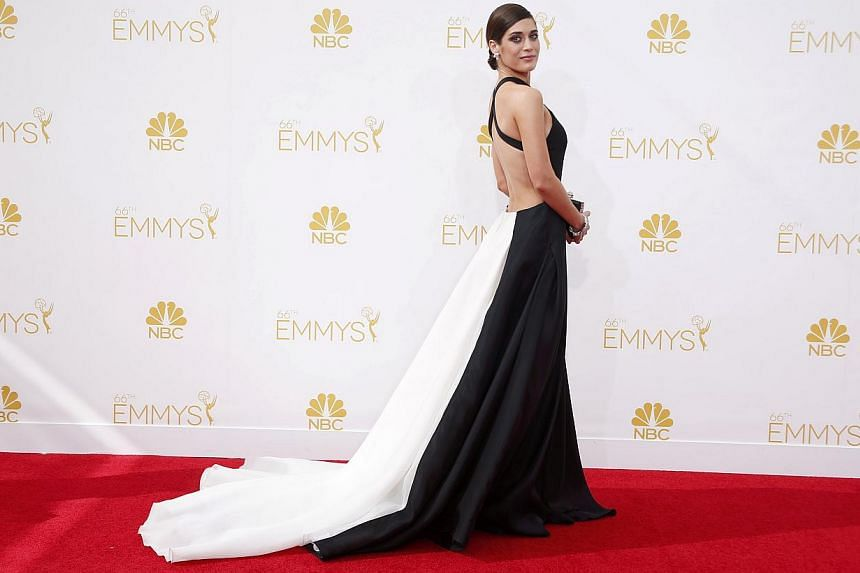 Lizzy Caplan from the Showtime series Masters Of Sex arrives at the 66th Primetime Emmy Awards in Los Angeles, California, on Aug 25, 2014. -- PHOTO: REUTERS