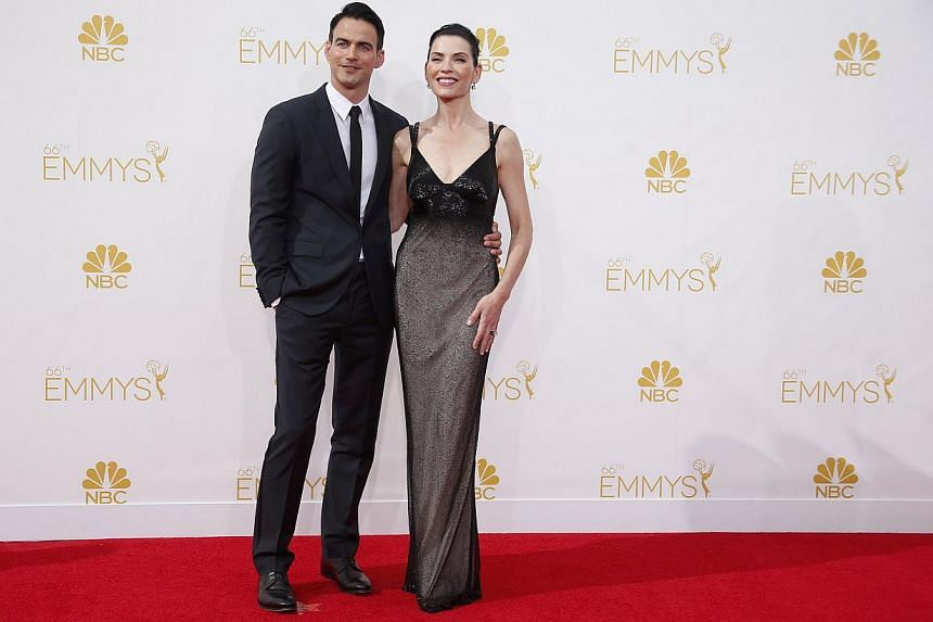 Julianna Margulies from the CBS series The Good Wife and husband Keith Lieberthal at the 66th Primetime Emmy Awards in Los Angeles, California on Aug 25, 2014. -- PHOTO: REUTERS