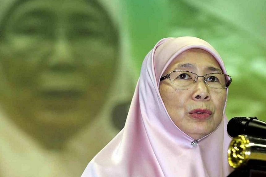 Parti Keadilan Rakyat (PKR) president Wan Azizah Wan Ismail giving her opening policy speech during the party's 10th national congress at Stadium Melawati in Shah Alam on Aug 23, 2014. -- PHOTO: THE STAR/ ASIA NEWS NETWORK