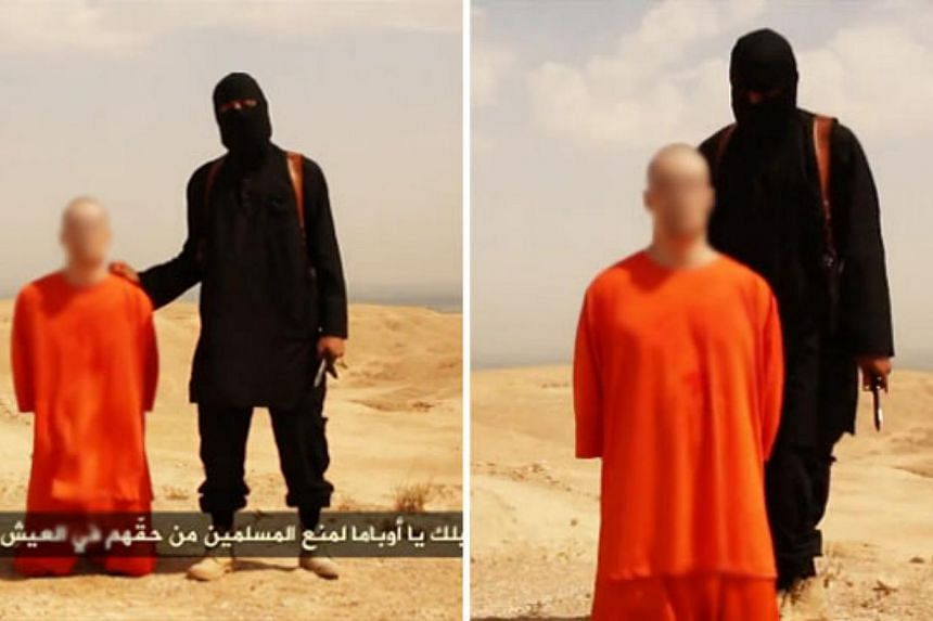 Investigators identifying the killer of American journalist James Foley now believe there are two masked fighters in the execution video - one who made the English speech and one who beheaded him. -- PHOTO: INTERNET