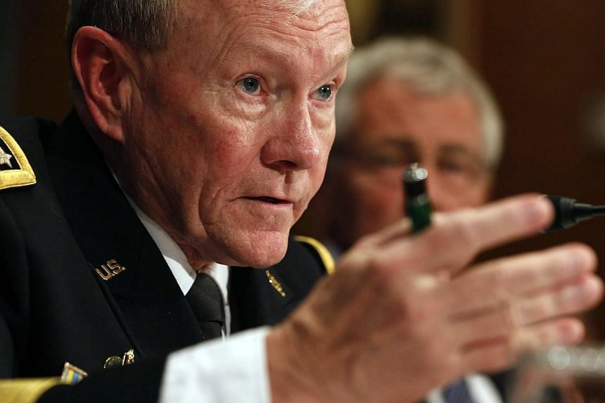 """Chairman of the Joint Chiefs of Staff, General Martin Dempsey, speaks during a committee meeting on Capitol Hill in Washington on June 18, 2014. He believes Islamic State extremists will """"soon"""" pose a threat to America and Europe and that an internat"""