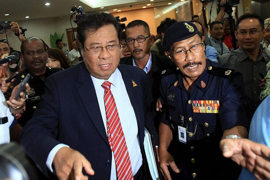 Selangor's sultan on Tuesday asked Tan Sri Abdul Khalid Ibrahim (left) to postpone his resignation as the state's chief minister until the palace can determine his replacement. -- PHOTO: THE STAR/ASIA NEWS NETWORK