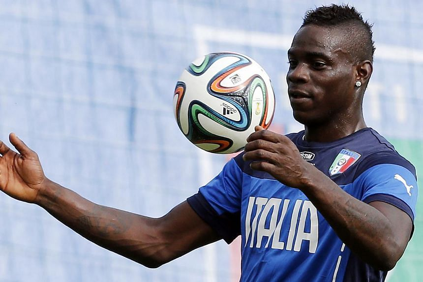 Italy's national soccer player Mario Balotelli in action at a training session during the 2014 World Cup.  Liverpool completed the transfer of the AC Milan striker on Monday. August 25, 2014.  -- PHOTO: REUTERS