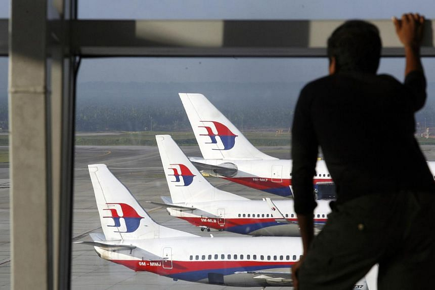 Nearly 200 cabin crew have resigned from Malaysia Airlines which was hit by two deadly tragedies this year, the carrier said on Tuesday, and some reportedly cited fears for their safety. -- PHOTO: REUTERS