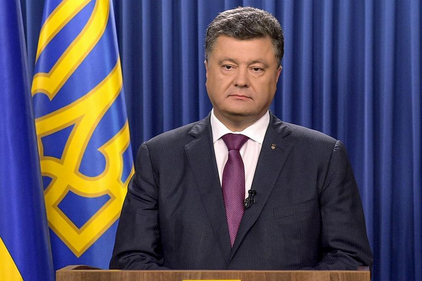 This handout picture taken and released by the presidential press-service shows Ukrainian President Petro Poroshenko during hisTV address to the nation in Kiev on August 25, 2014. Ukraine will hold early parliamentary elections on October 26 followin