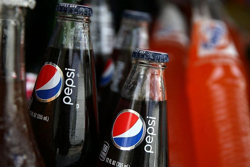Bottles of Pepsi are displayed in a food truck's cooler on July 22, 2014 in San Francisco, California.India has asked US soft drinks giant PepsiCo to reduce the sugar content of its sodas as the country battles growing levels of obesity and dia