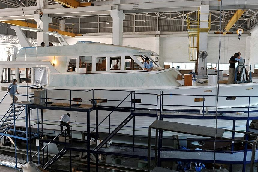 Building yachts to order at Grand Banks Yachts.Stronger demand for luxury boats in North America and Asia helped Singapore-listed yacht maker Grand Banks Yachts post its first full-year profit in six years. -- PHOTO: ST FILE