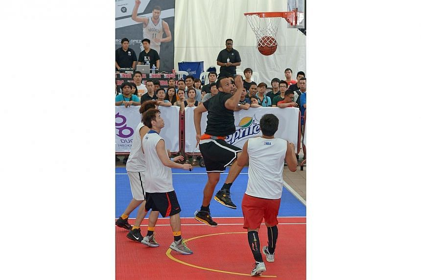 DnD's Kyle Jeffers (black top) scores against Siglap in the men's open final of the NBA 3X tournament on Sept 1, 2013. NBA legend Horace Grant will headline the NBA 3X when it returns to Singapore in September. -- PHOTO: ST FILE