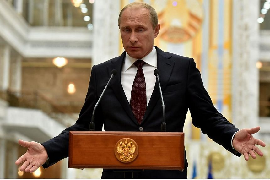 Russia's President Vladimir Putin gives a press conference after a summit in Minsk early on Aug 27, 2014.Ukraine accused Russian forces of launching a new military incursion across its border on Wednesday, Aug 27, 2014, a day after the leaders