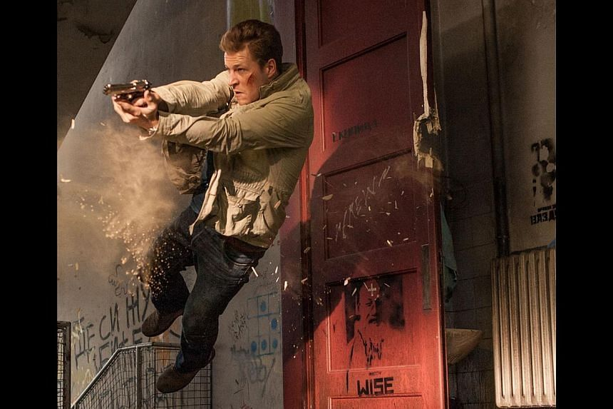 Luke Bracey had never handled firearms before filming November Man and had to train hard to look convincing as a gun-toting spy in the movie. -- PHOTO: SHAW ORGANISATION