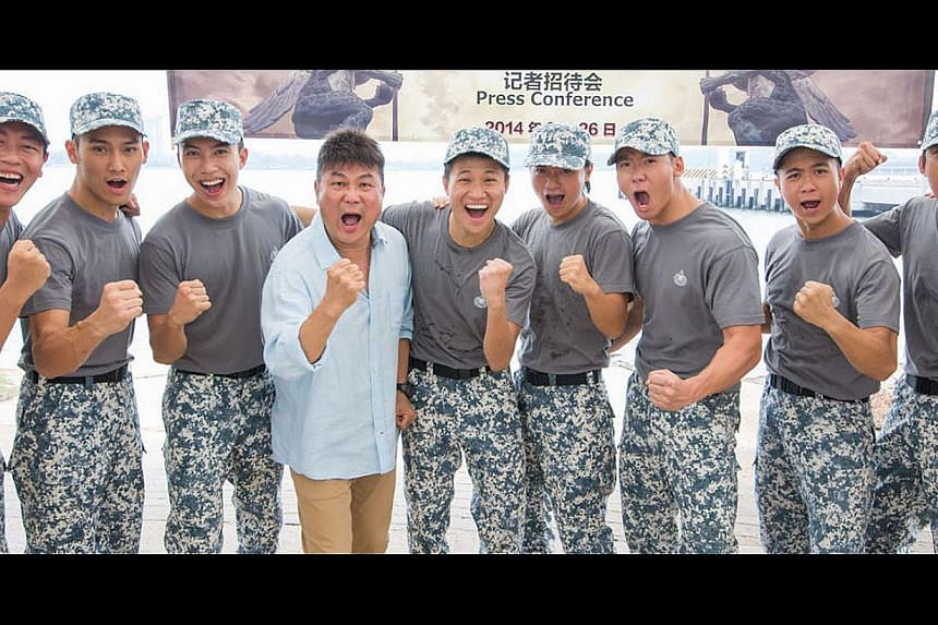 Director Jack Neo (in blue shirt) will direct the third instalment of Ah Boys To Men with a cast of old and new faces, such as Wesley Wong (second from left). -- PHOTO: GOLDEN VILLAGE PICTURES