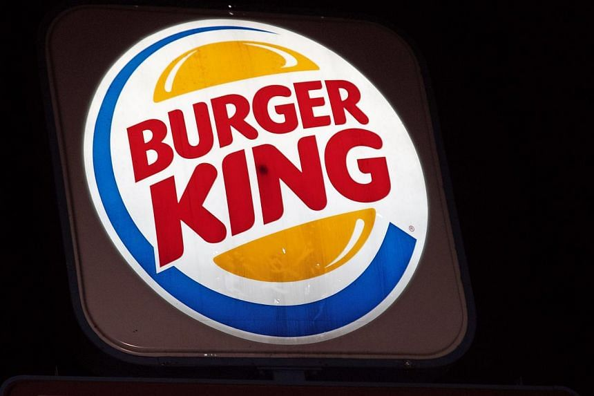 An illuminated Burger King sign is seen in Washington, DC on Aug 25, 2014. -- PHOTO: AFP