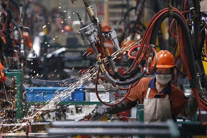 An employee works at a production line inside a Geely factory in Ningbo, Zhejiang province, in this May 15, 2014 file photo. -- PHOTO: REUTERS