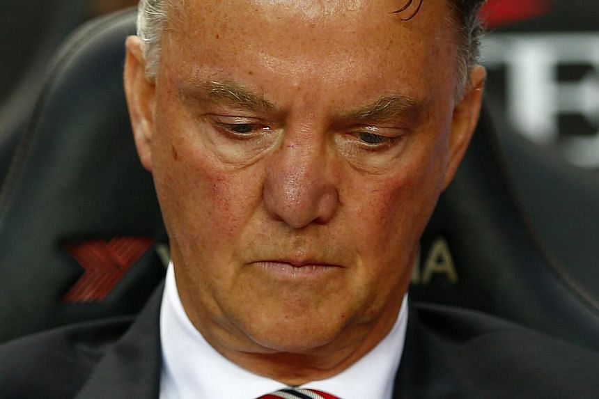 Manchester United manager Louis van Gaal reacts in the League Cup game against Milton Keynes Dons at Stadium MK in Milton Keynes, north of London on Aug 26, 2014. -- PHOTO: REUTERS