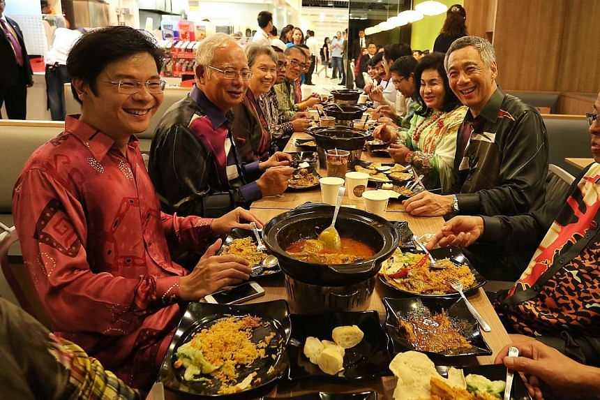 Prime Minister and Mrs Lee Hsien Loong hosted dinner at My Briyani House, Kallang Wave Mall, on Aug 27, 2014. -- ST PHOTO: NEO XIAOBIN