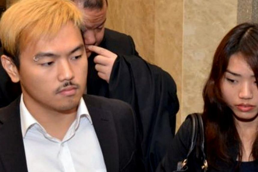 Controversial Malaysian sex bloggers Alvin Tan (left) and Vivian Lee leaving the Sessions Court in Kuala Lumpur on May 12, 2014. -- PHOTO: THE STAR/ASIA NEWS NETWORK