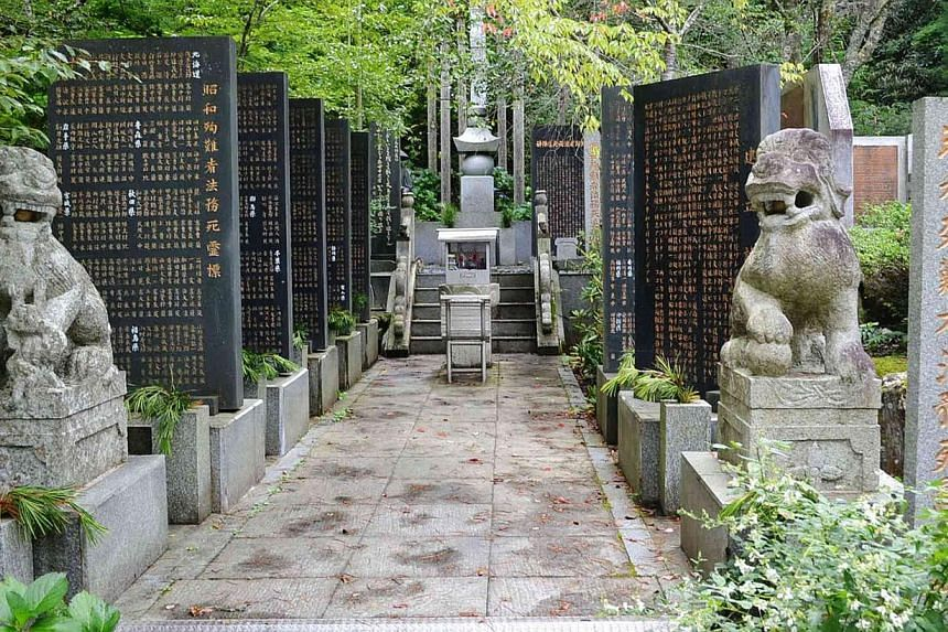 """A memorial compound, honoring more than 1,000 """"Showa Martyrs"""", is seen in Koyasan Okuno-in temple in Koya town, central Japan, on Aug 27, 2014.South Korea slammed Japanese Prime Minister Shinzo Abe on Thursday, Aug 28, for sending a message of"""