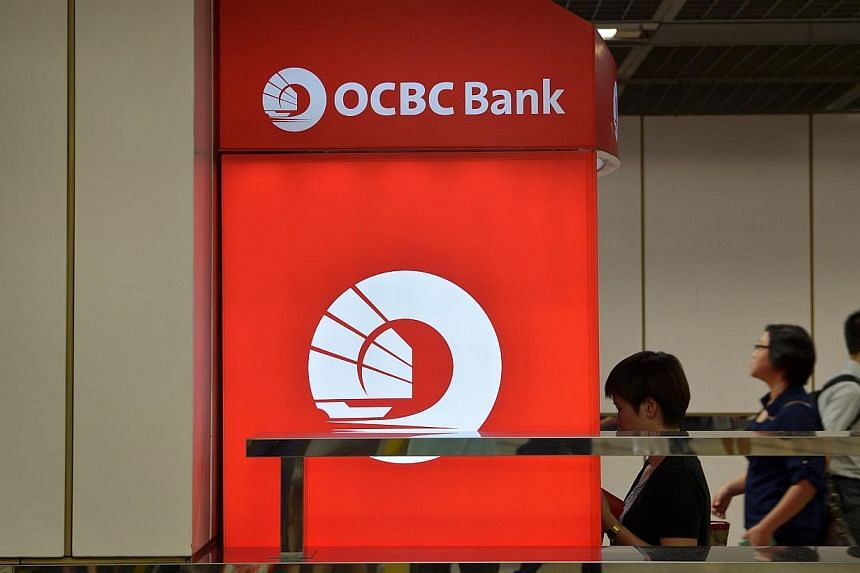 Local bank OCBC is making use of its ATM network and popular 360 Account to make its recently announced rights issue more attractive for its customers. -- PHOTO: ST FILE